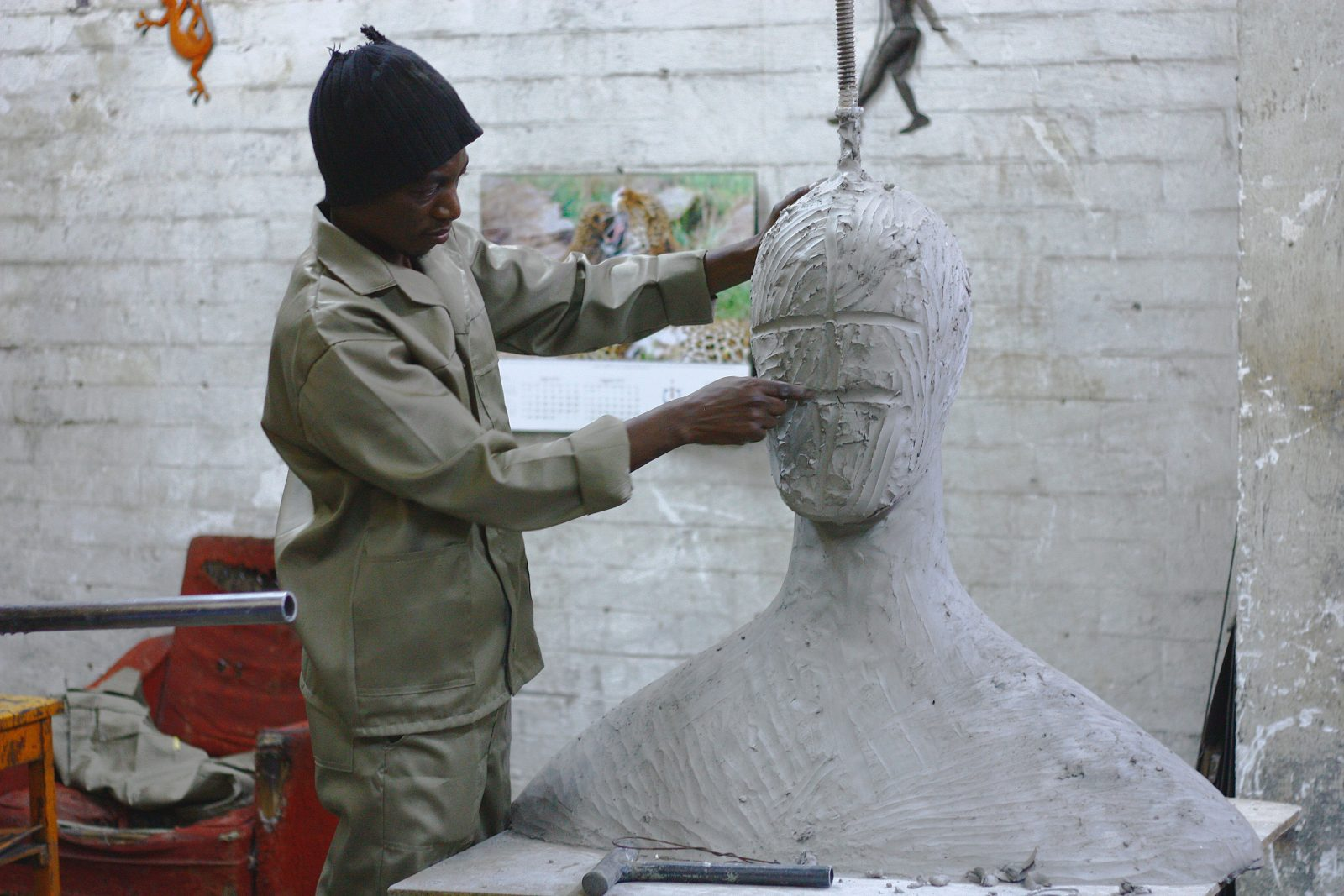 Sculpter working on a clay sculpture